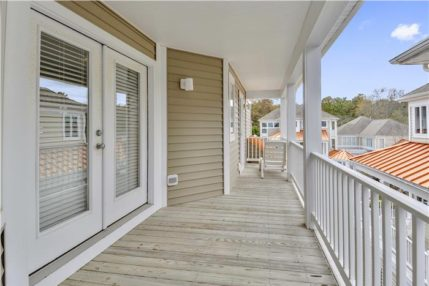 Both the upper and middle floors have access to decking which surrounds the house.