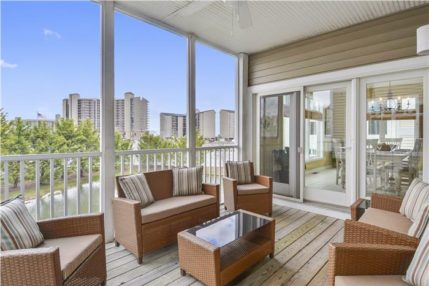 The screened in porch has a view of the pond and Sea Colony Towers.